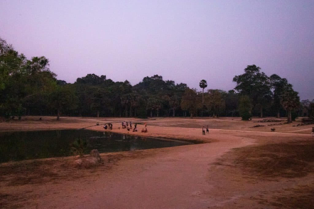sparse crowd at sunrise for Angkor Wat
