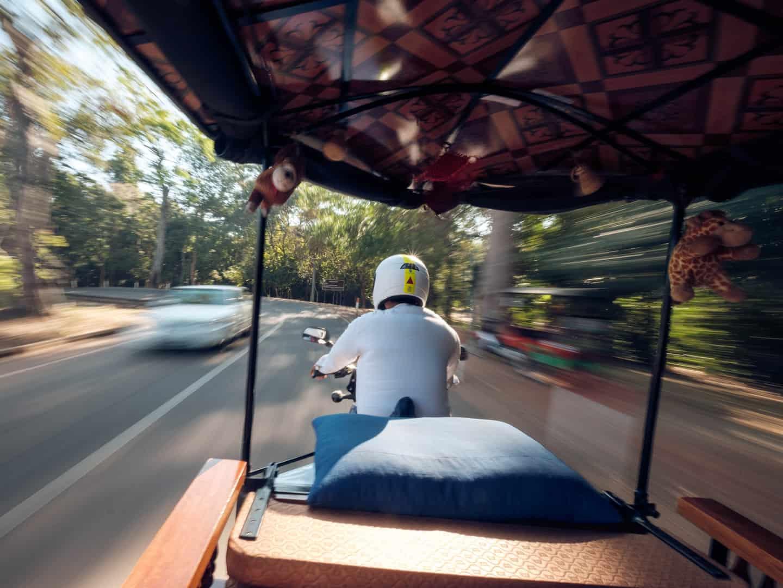 Tuk-tuk speeding through side roads at Angkor Wat
