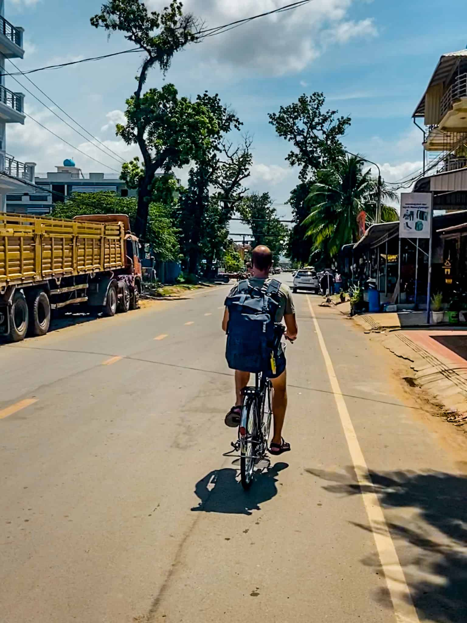 Nate Riding a Bike Through the Streets of Kampot, Cambodia