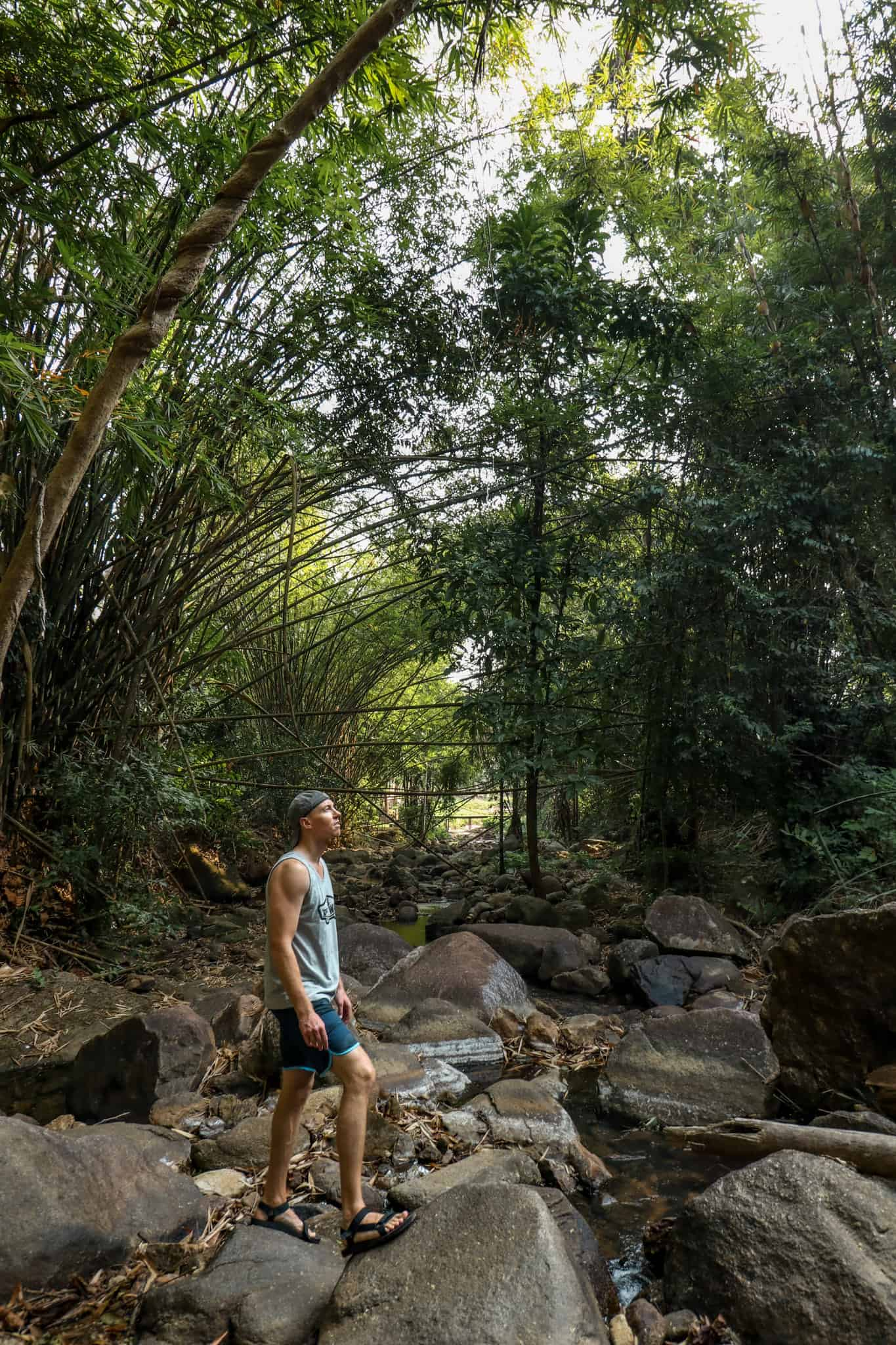 Nate on a river during hike in Phuket, Thailand