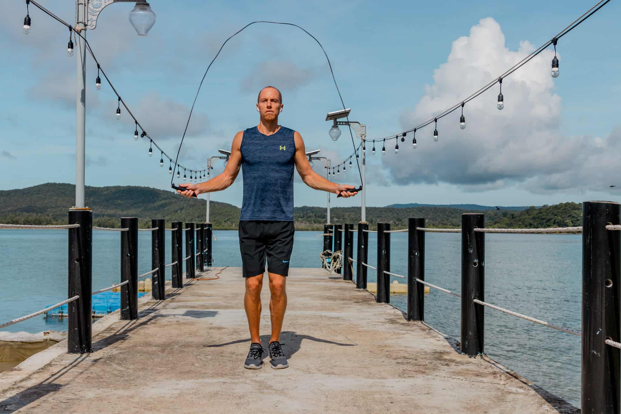 Nate jumping rope on dock in Koh Rong, Cambodia