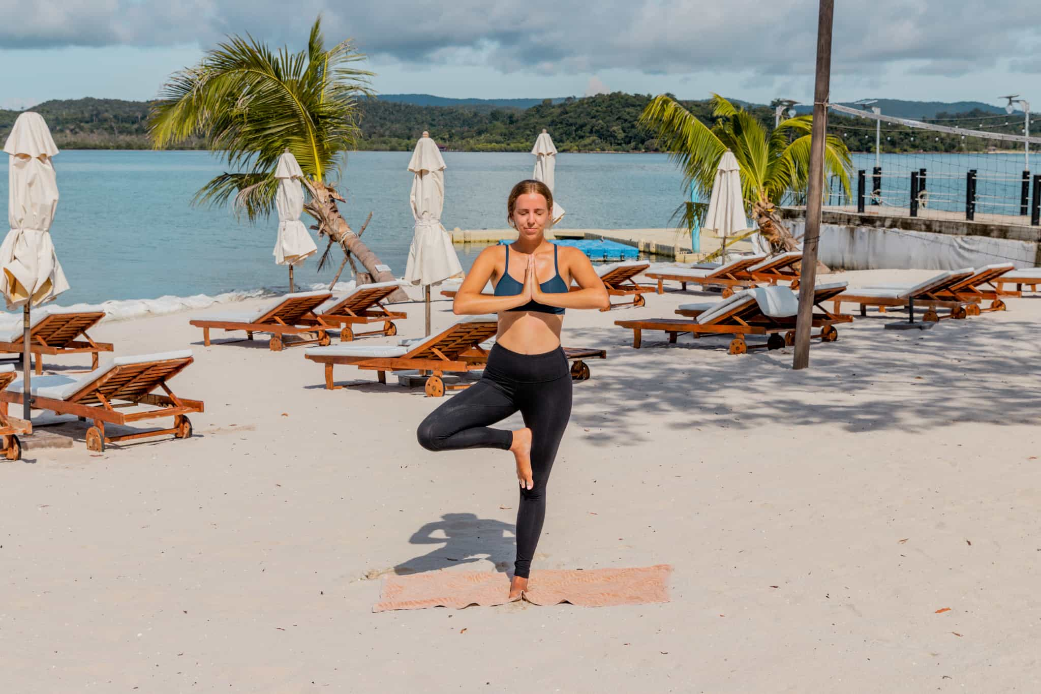 Alicia doing yoga on beach in Koh Rong, Cambodia